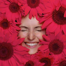 Happy young woman with flowers. Woman fa