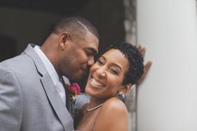 Groom kisses bride's cheek during their elopement at Brakefield