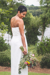 Bride shows off back of dress