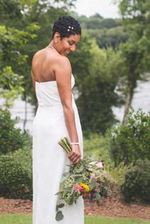 Bride shows off back of dress