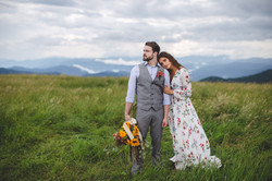 Bride and groom embracing at Max Patch (mountain bald)