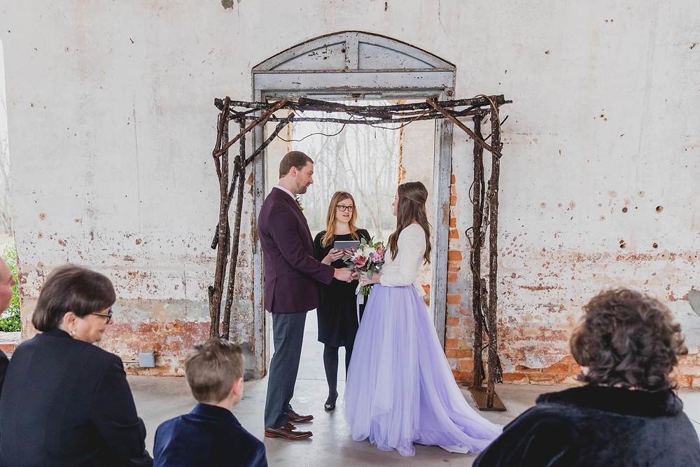Minister/Officiant performs ceremony for couple at Providence Cotton Mill
