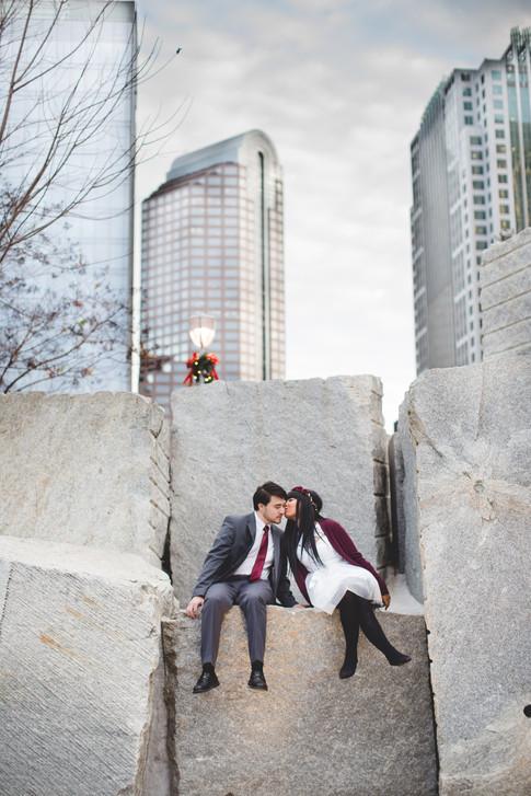 Bride and groom kiss in Romare Bearden park