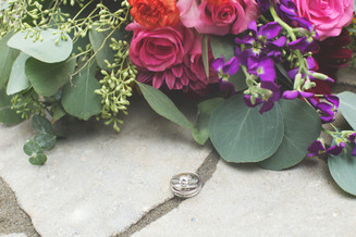 Wedding rings with wedding bouquet