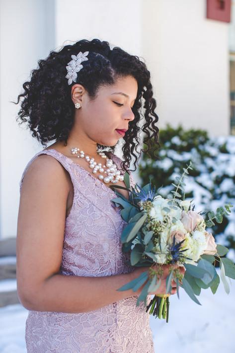Bride holds wedding bouquet