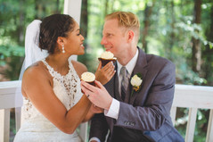 Bride and groom share wedding cupcakes at Jetton Park