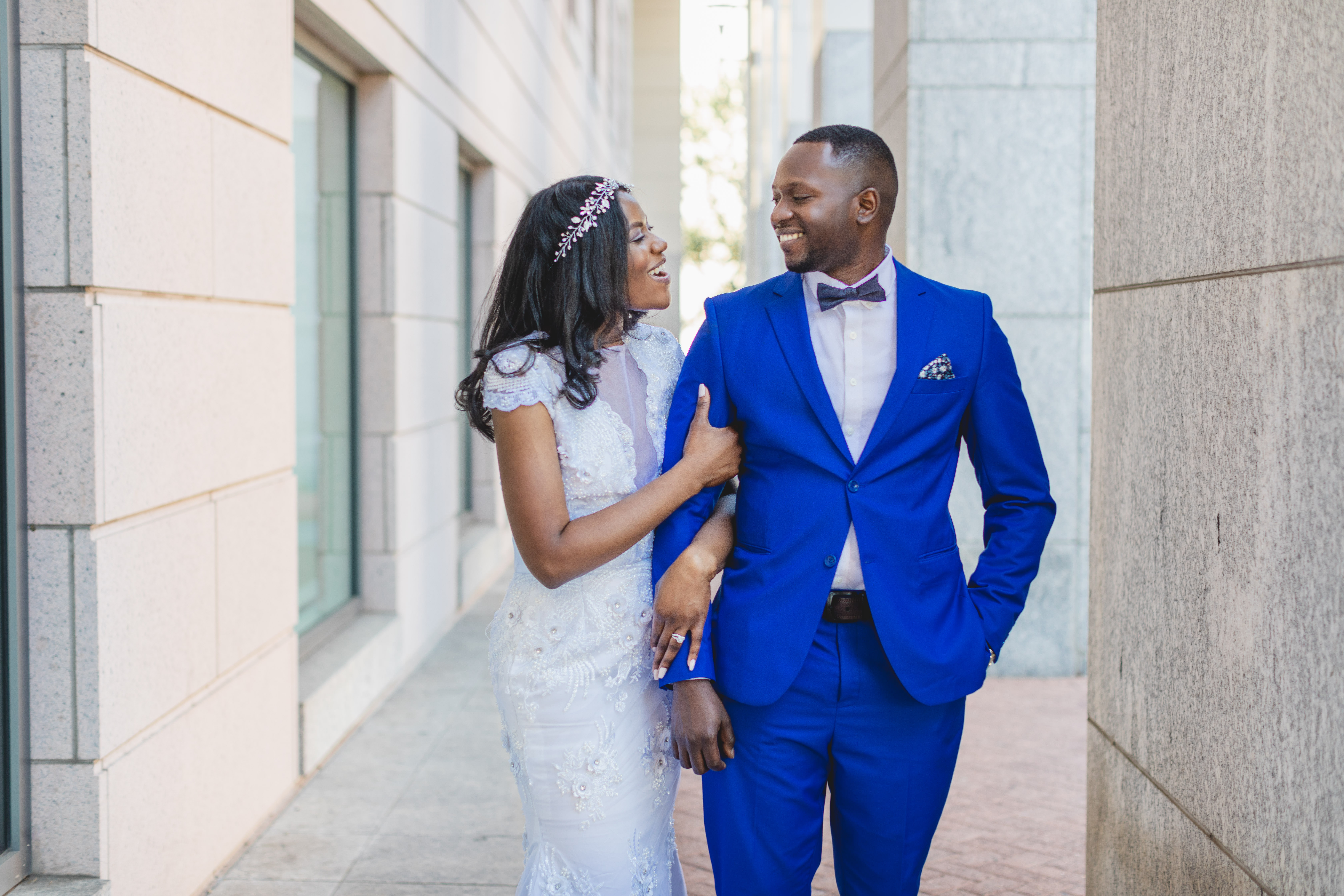 Bride and Groom smiling at each other at Mecklenburg Court House, Charlotte, NC