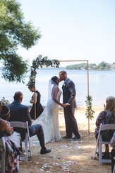 Bride and groom share first kiss at Jetton Park waterfront