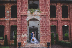 Bride and Groom kissing in front of Providence Cotton Mill