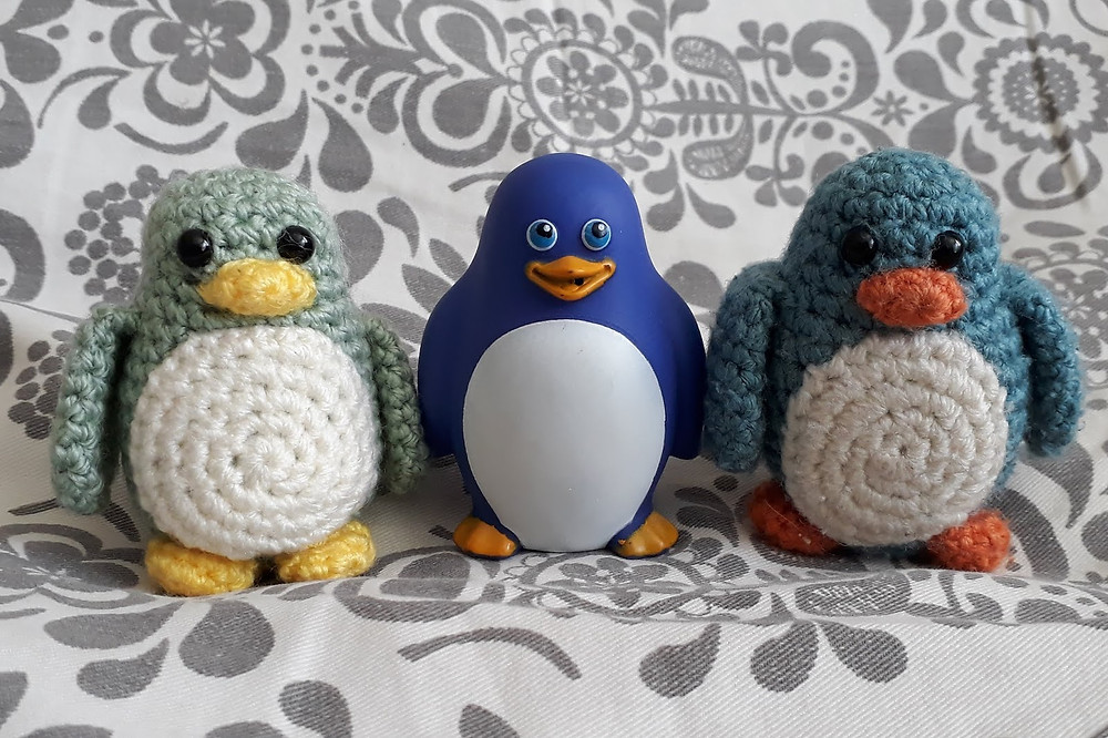squirty bath toy penguin and his crochet penguin pal