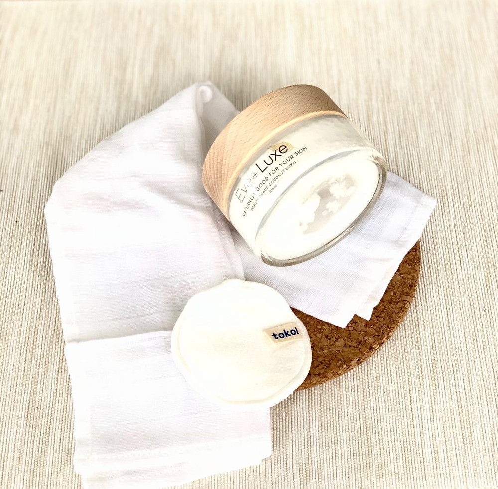 Eve + Luxe coconut elixir jar with an organic muslin cloth, organic cotton rounds instead of disposable face wipes.
