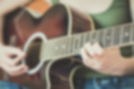 Close up of somone playing the guitar