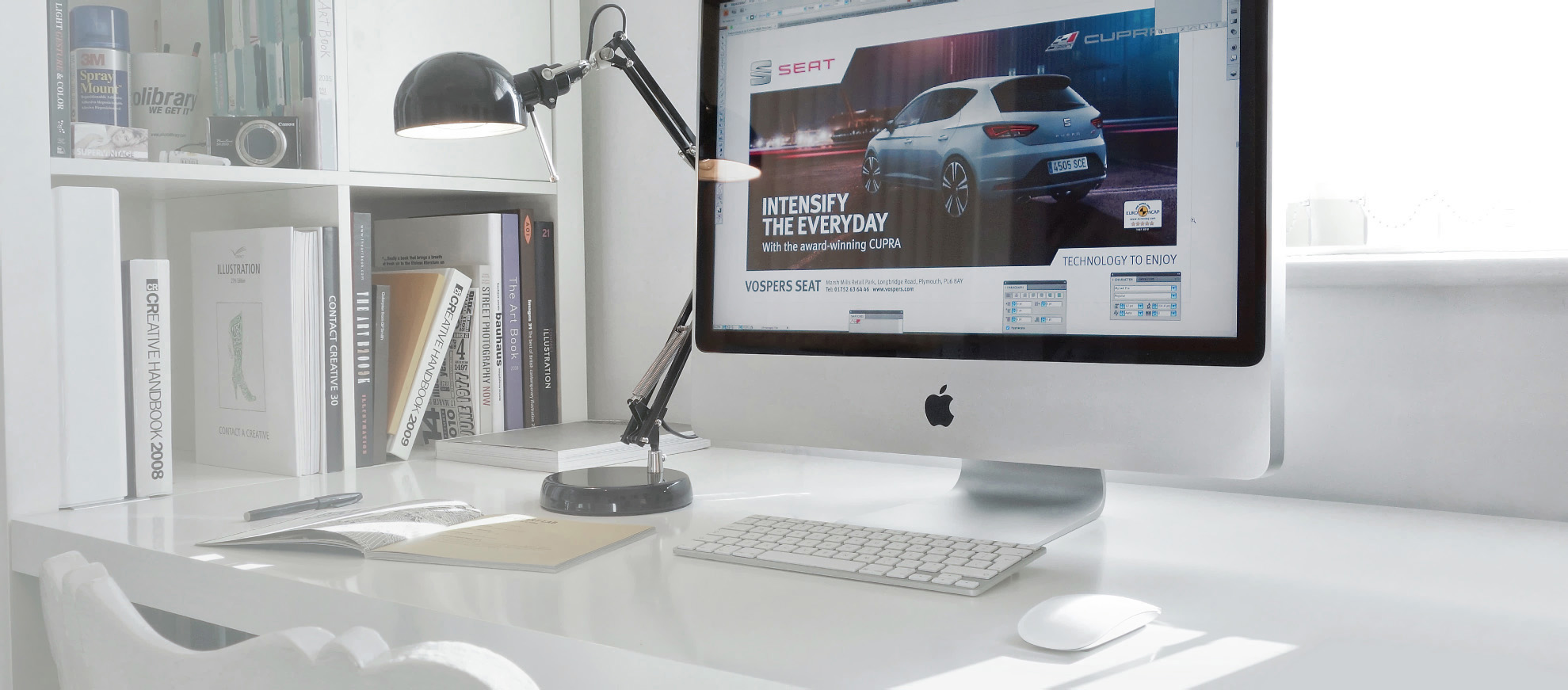 Car poster design on computer screen