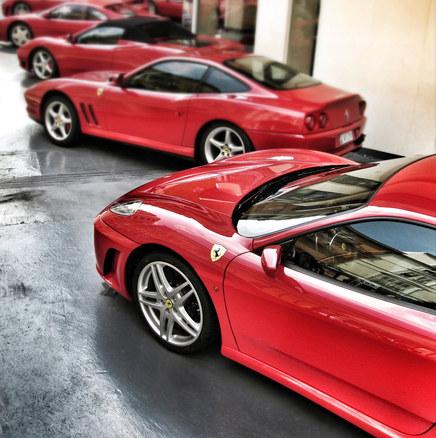 Red Ferraris at garage in Monaco