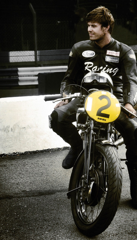 Vintage race bike and rider at Donington Classic Festival
