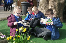 Reading books in the playground.jpg