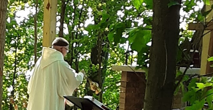 Fr. Richard Crawley, OFM Cap. blessing our altar.