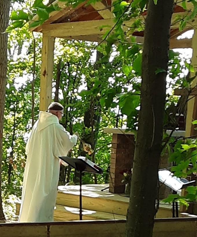 Fr. Richard Crawley, OFM Cap. blessing our altar.