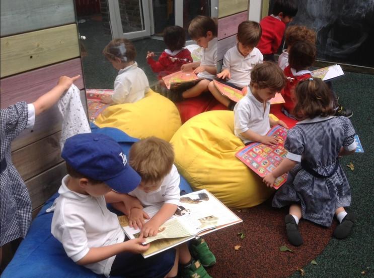 Reading outside in the Nursery