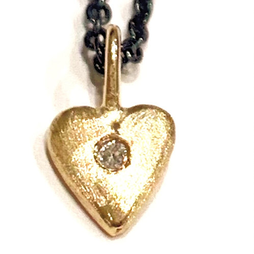 gold heart with diamond