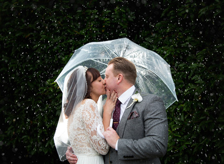 Gina & Phil's very very wet Tewin Bury Farm wedding...