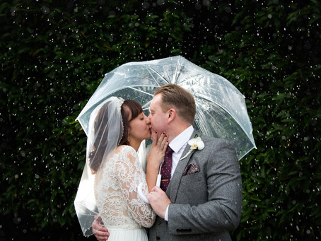 Gina & Phil's very very wet Tewin Bury Farm wedding...