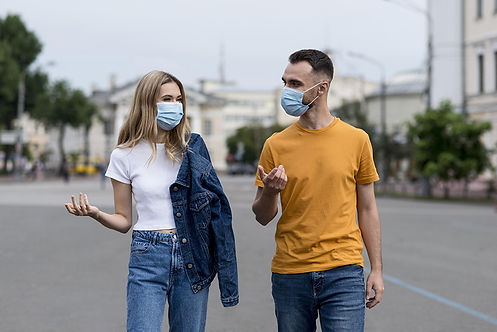 young-friends-wearing-medical-masks.jpg
