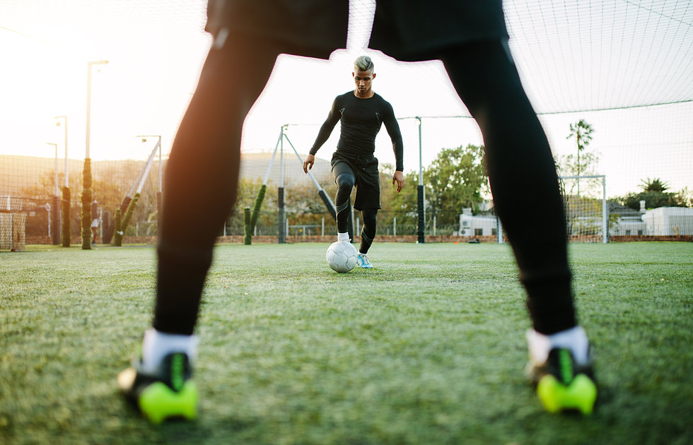 Young soccer players training in footbal