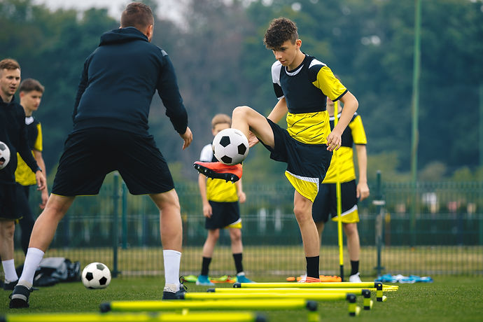Teenagers on soccer training camp. Boys