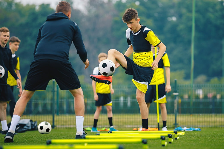Teenagers%20on%20soccer%20training%20camp.%20Boys%20practice%20football%20with%20young%20coaches.%20