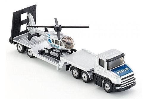 Camion con semirimorchio ribassato con elicottero