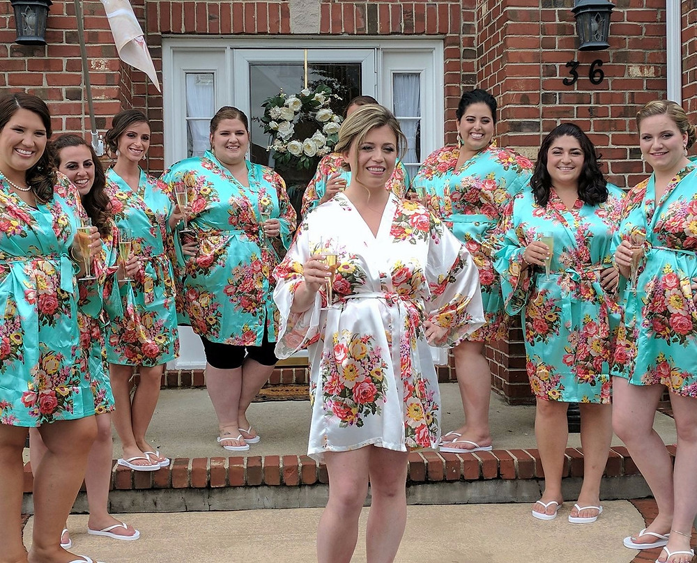 bride and bridal party in floral robes