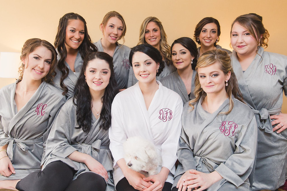 bride and bridesmaids in grey matching robes