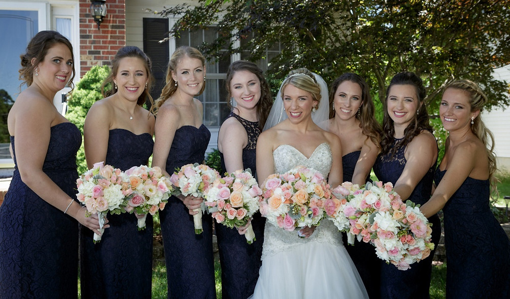 Bride with bridesmaids in navy dresses