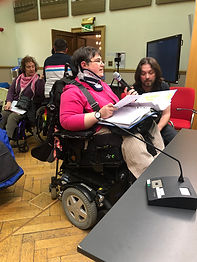 women in a wheelchair giving evidence
