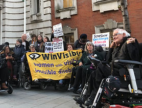 group of disability campaigners outside the town hall campaigning against care charges