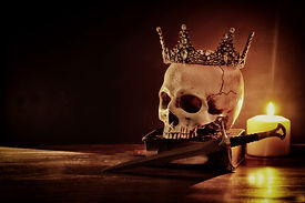 Human skull, old book, sword, crown and