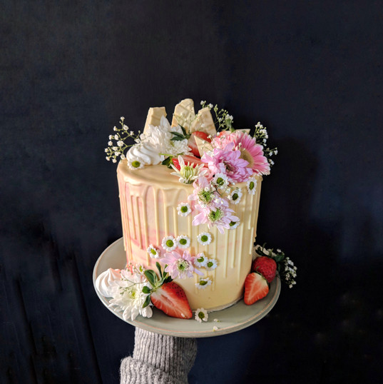 Drip cake on pink watercolour