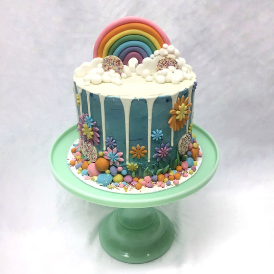 Rainbow cake on blue