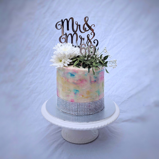watercolour cake with silver accents and diamond ribbon