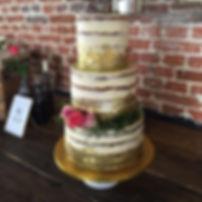 Gold leaf, rosemary wreath semi naked cake
