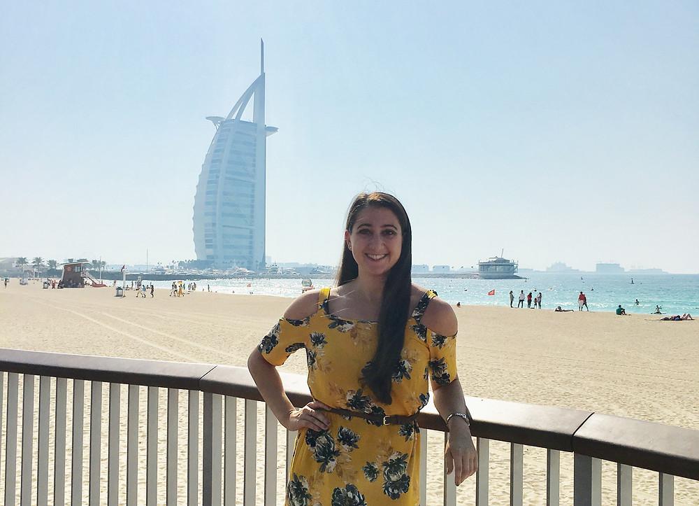 jenny bakalian standing on dock of united arab emirates beach