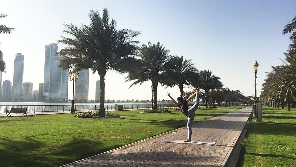 jenny bakalian performs yoga pose outdoors