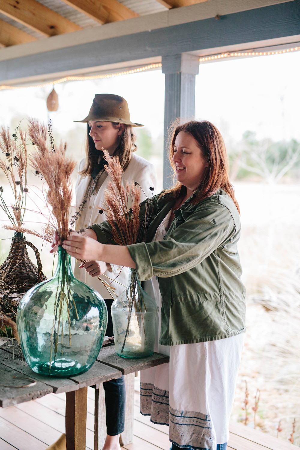sisters in law rhoda and anna founders of loot rentals styling an outdoor display