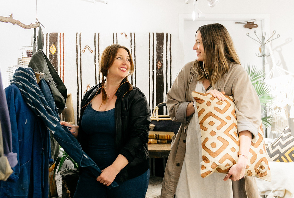 sisters in law rhoda and anna founders of loot rentals styling a display