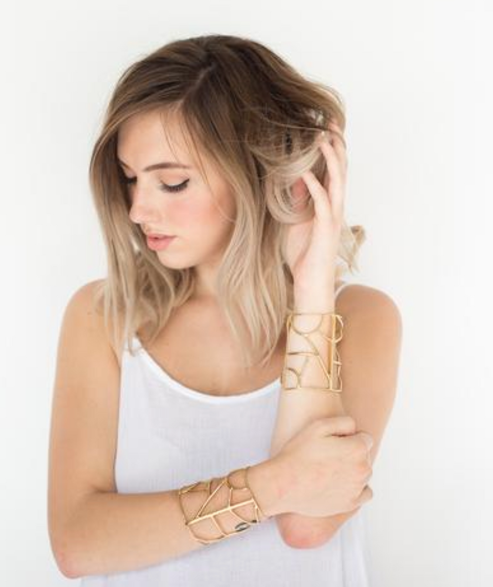 blonde woman wearing gold nina berenato bracelets