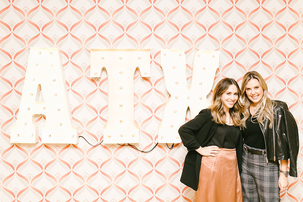 kendra scott and jaclyn johnson in front of ATX backdrop at WorkParty in Austin