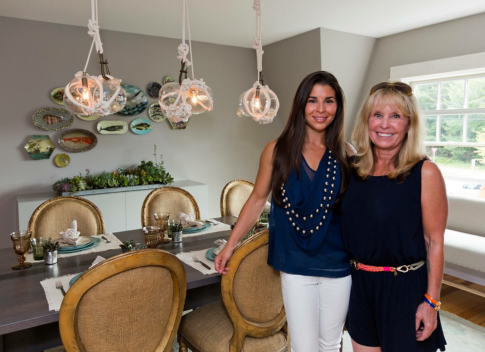 tyler karu poses with her mother in front of renovated and styled dining room