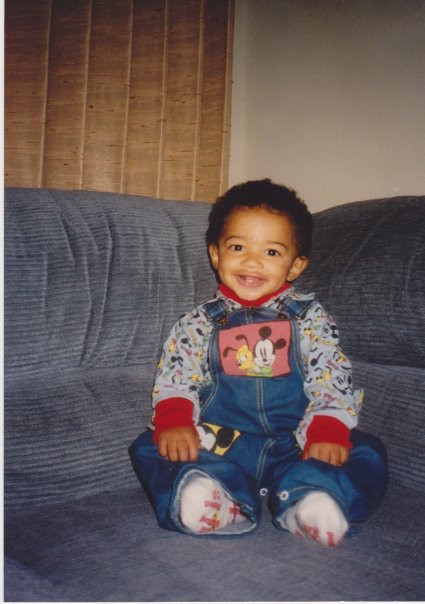 Little me on our family couch