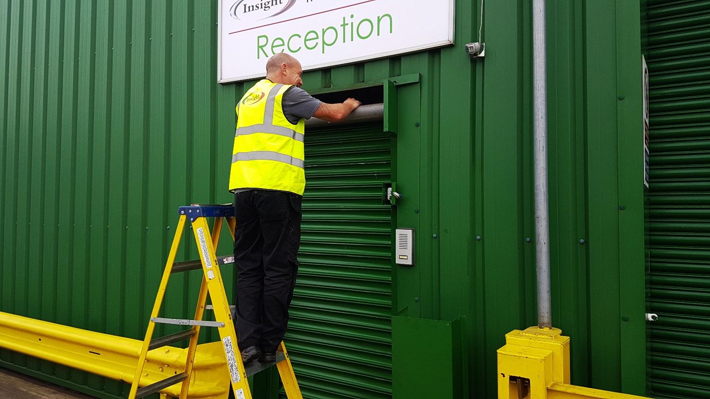 Insightuk Engineer fixing our Roller Shutter door